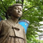 "Memorial statue for the remembrance of ""comfort women"" near Ehwa Women's University in Seoul (2016), by Benson Cheung."