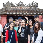 "Students arrive in Da Nang, Vietnam. Here, they are standing at the entrance of ""Hoi An Covered Bridge"". Photo: Timothy Tse."