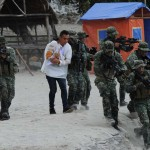 Philippine marines run as they simulate the rescue of a hostage victim as part of an amphibious raid and special operations exercise by the navy at a marine training base in the town of Ternate in Cavite province, west of Manila on September 24, 2015, days after gunmen abducted three foreigners and one Filipina from a luxury island resort on Samal island. Gunmen holding three foreigners and one Filipina hostage slipped past a naval cordon and escaped to remote mountains in the southern Philippines, leaving few clues to their identities, police said on September 23. AFP PHOTO / TED ALJIBE (Photo credit should read TED ALJIBE/AFP/Getty Images)
