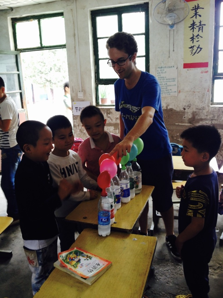 Tongxin students inspect the results of a science experiment