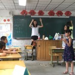 students in classroom with teachers Melody Liang and Zitong Li