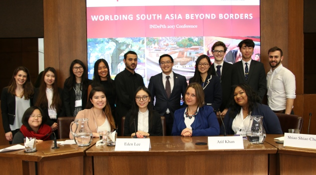 The student executive team of the 2017 INDePth Conference pose in the Vivian and David Campbell Conference Facility. The slide behind them reads: Worlding South Asia Beyond Borders.