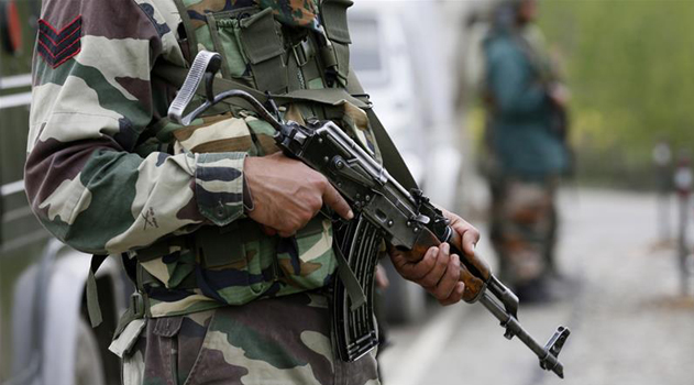 close up on the body of a soldier holding an automatic weapon.