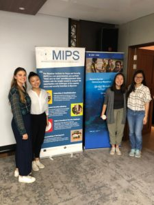 CAS students in Yangon, Myanmar pose with MIPS banners