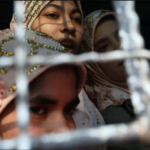 Arrested Rohingya women leave a court near Yangon, Myanmar, on Feb. 21. A month earlier, the International Court of Justice (ICJ) ordered Myanmar to take urgent measures to protect its Muslim Rohingya population from persecution and atrocities, and preserve evidence of alleged crimes against them. (Ann Wang/Reuters)