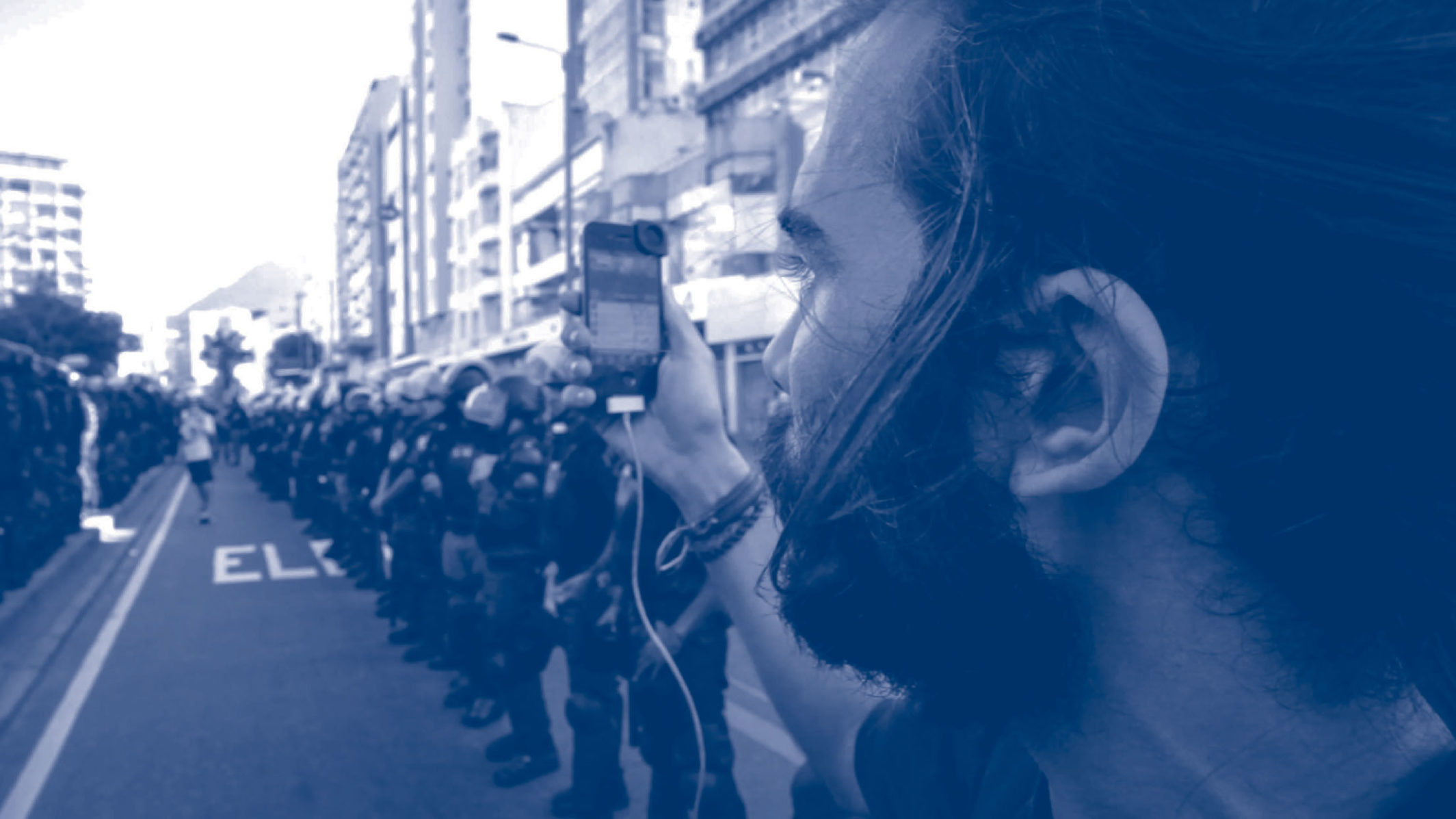 A man photographing a protest.