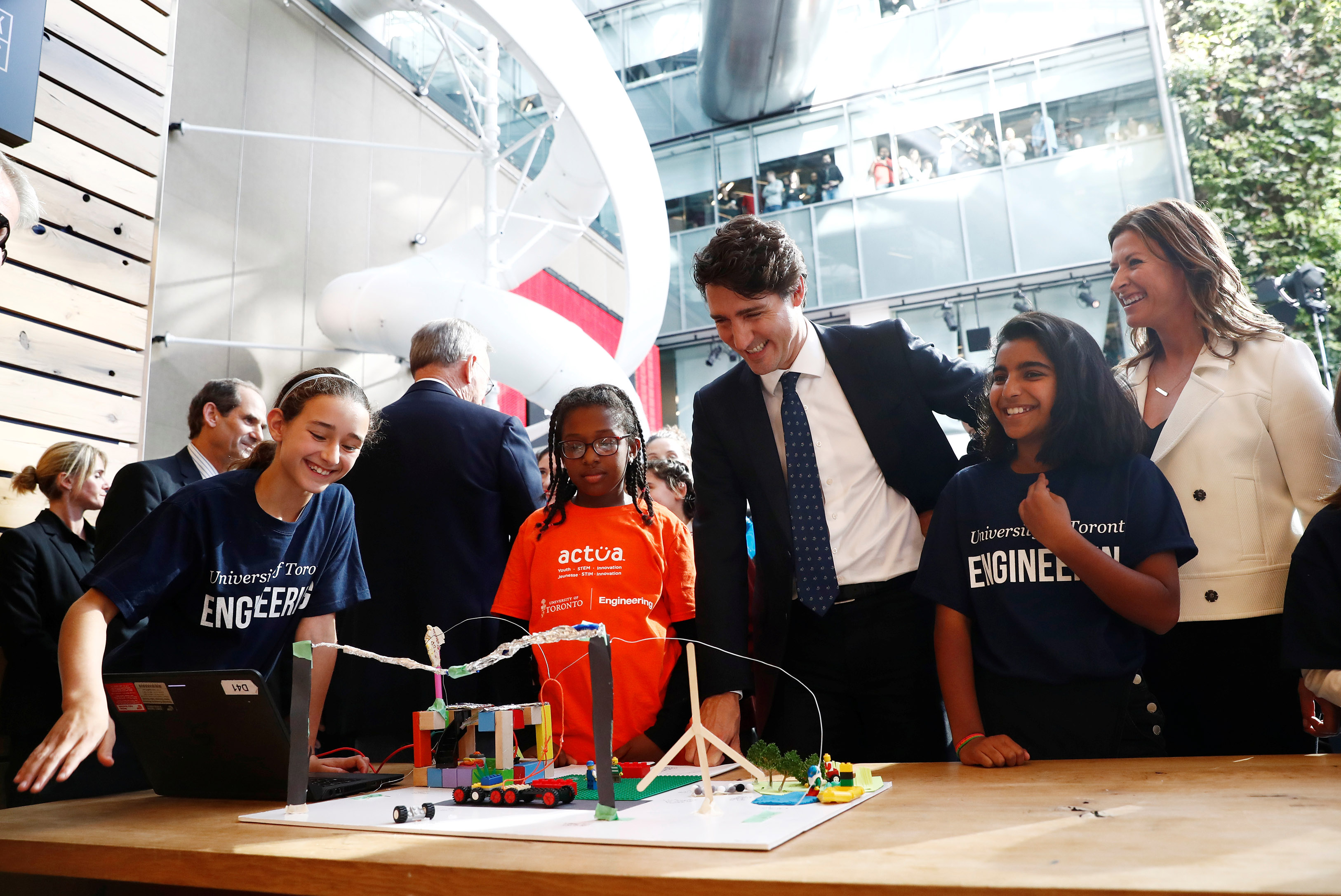 Prime Minister Justin Trudeau and children attend press conference.