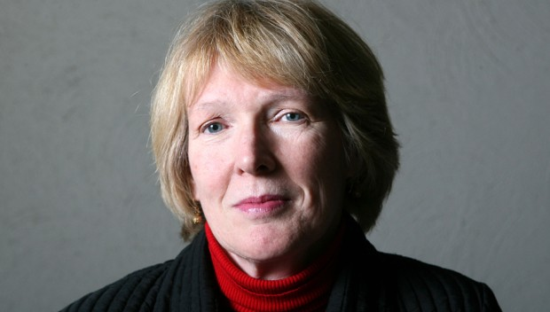 A portrait of Margaret MacMillan dressed in red and black