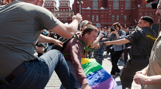 An image of a Russian nationalist kicking a gay rights activist