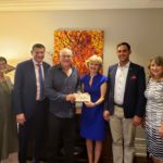 Photo of check presentation for donation to Hungarian Studies Program
