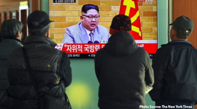 South Koreans at a railway station in Seoul watching a broadcast of North Korea's leader, Kim Jong-un