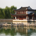 Traditional chinese home on the water and trees