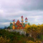 Colourful castle and trees on a cloudy day