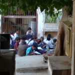School children studying in a courtyard
