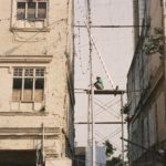 Man on scaffolding between two buildings