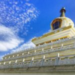 White and yellow shrine under a blue sky