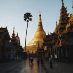 A golden Buddhist pagoda and other buildings