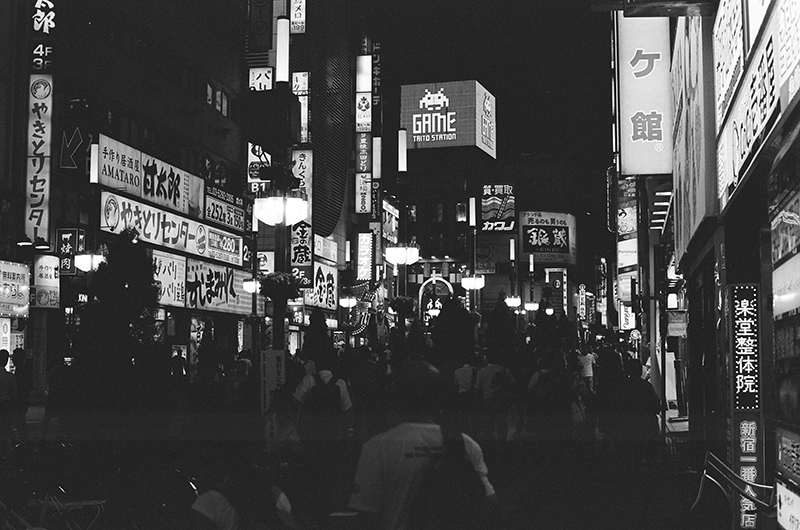 """Photo in Andy Takagi's """"Summertime in Tokyo"""" series; the image shows neon lights lining the street in Shinjuku"""