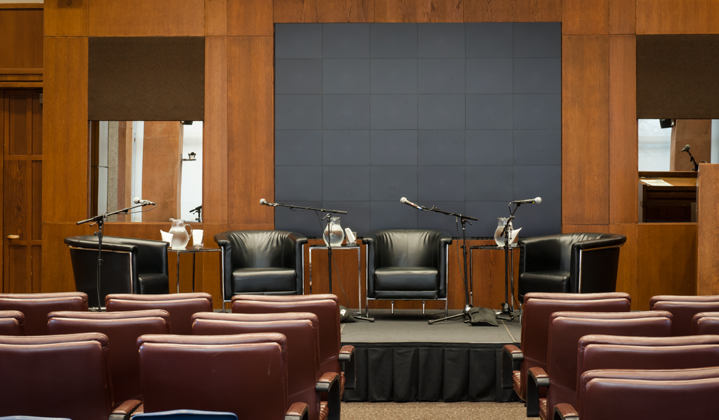 Stage with 4-chair comfy chair setup in Campbell Conference Facility