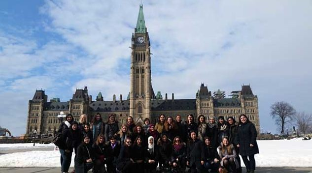 Shot of the Women in House participants in front of the Canadian Parliament