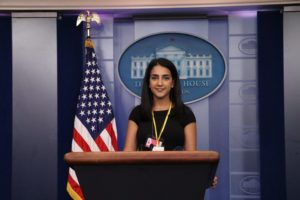 Sayeh Yousefi standing at a podium at the White House Press Pool