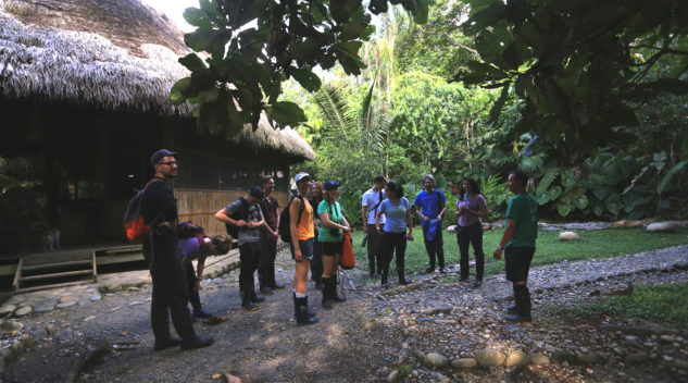 The group learning about the local people, cultures, and biodiversity before setting off for a hike in the Amazon