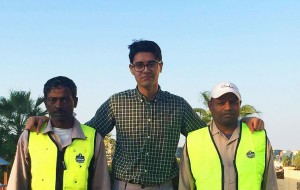 Adam Sheikh, centre, spent the summer with colleagues in Qatar testing a cooling vest safety intervention