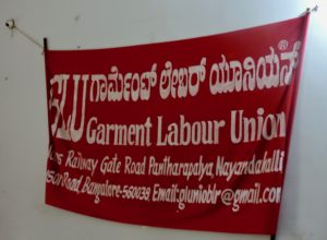 A banner hanging in the Garment Labour Union office in Peenya, Bangalore.