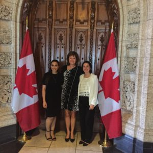 Maria-Alba Benoit Maraica with MP Damoff and fellow participant Yara at the doors to the House of Commons.