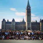 A group photo of the 2017 Women in House cohort in front of the Parliament Buildings in Ottawa.