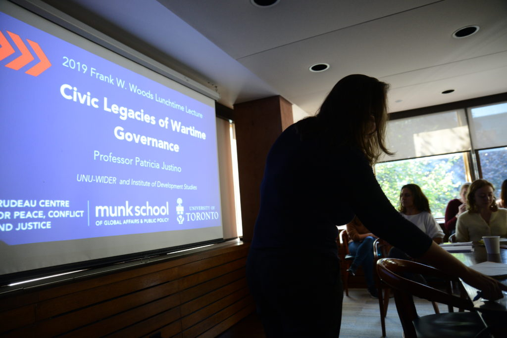 """Professor Justino presents her research, """"Civic Legacies of Wartime Governance"""" during the Frank W. Woods Lunchtime Lecture"""