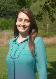 Photo of Evelyn Boychuk in a blue shirt standing outdoors