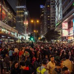 Wide shot of large crowd in Hong Kong, by Alexander Synaptic: https://www.flickr.com/photos/synapticism/13782894124