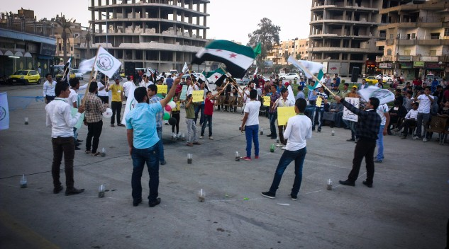 Picture of people protesting in Syrian city of Ar-Raqqah, courtesy of Beshr O: https://www.flickr.com/photos/beshro/8647270729
