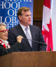 Picture of Janice Stein and John Baird standing nearby a podium