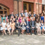 Director Stephen Toope stands outdoors with a group of graduating students from the Master of Global Affairs program.