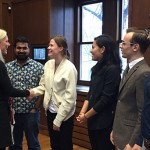Catherine McKenna shakes hands with students