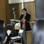 Lynette Ong lectures to a room full of students.