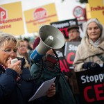 A group of protesters speak out against the Canada-Europe Trade Agreement