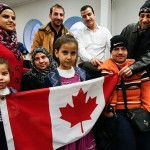 A Syrian refugee family at a welcoming dinner on Toronto's waterfront