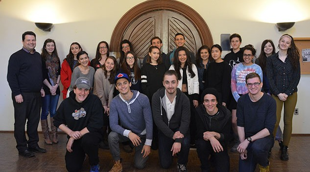 Themistoklis Aravossitas stands with his modern Greek language class in a group photo.