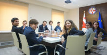 Students sitting in a boardroom