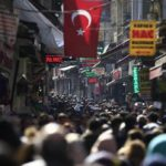 People fill an open market in the historic Sultanahmet district of Istanbul.