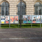 Campaign posters line a street in France