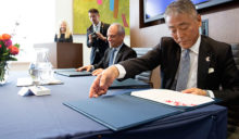 Yasunori Nakayama and Meric Gertler sign agreement at announcement ceremony.