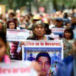 Friends and relatives of 43 missing students at a protest in Mexico City.