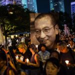 Crowds hold a candlelight vigil for Chinese dissident Liu Xiaobo