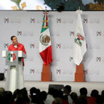 President Enrique Pena Nieto giving a speech at a podium.