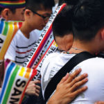 Supporters embrace during a rally after Taiwan's constitutional court ruled that same-sex couples have the right to legally marry, the first such ruling in Asia, in Taipei, Taiwan.