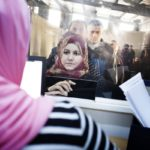 Syrian refugees line up at the UNHCR registration office in Jordan.